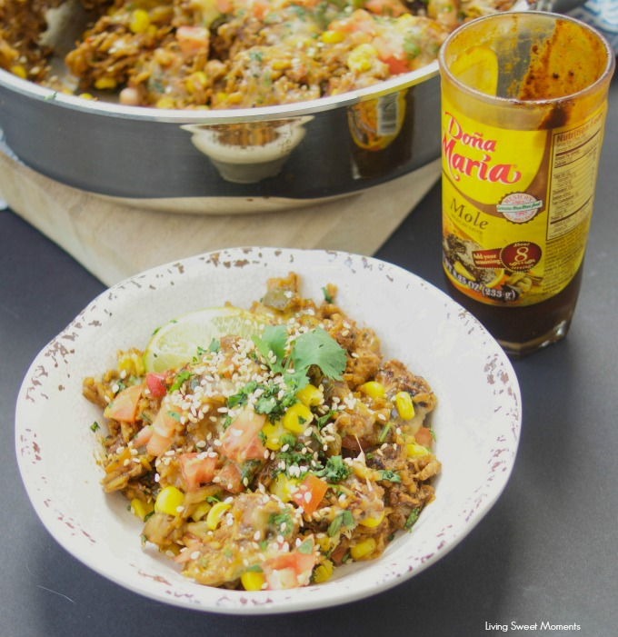 This amazing one pot cheesy Mexican Chicken And Rice recipe is made with authentic Mexican Mole sauce & topped with sesame seeds, for a quick 30-minute meal