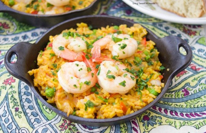 This delicious Spanish Shrimp With Yellow Rice recipe is super easy to make, ready in less than an hour, & feeds a crowd. Perfect for dinner or entertaining
