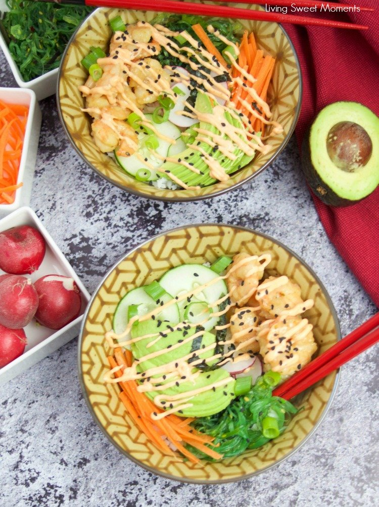 This delicious spicy shrimp poke bowl recipe is served with hot sushi rice, spicy mayo, avocados, radishes, and carrots. A quick weeknight dinner idea