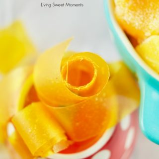 This amazing Mango Fruit Roll Ups recipe requires only 1 ingredient and is the perfect kid friendly healthy snack for the lunchbox. Vegan and Gluten Free.
