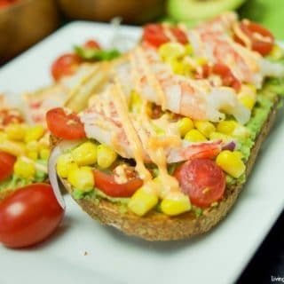 Looking for the best avocado toast recipe? You're in luck! This amazing Spicy Shrimp Avocado Toast is perfect for a quick & easy dinner or lunch idea.