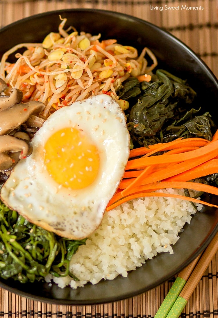 This amazing Korean Cauliflower Bibimbap recipe is delicious, low-carb, keto friendly, and easy to make. The perfect quick vegetarian weeknight dinner idea. Vertical closeup of the black bowl