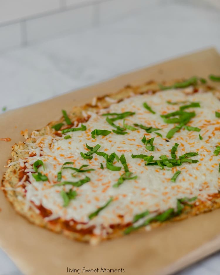This keto friendly Cauliflower Pizza Crust is crispy, delicious, low-carb, and super easy to make. Top with your favorite sauce and veggies & it'll be a hit