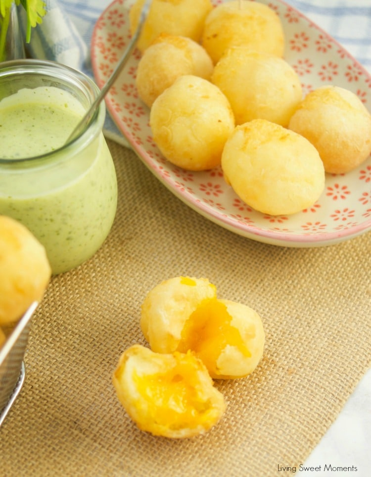 These amazing Cheese Stuffed Yuca Balls are crispy, delicate, and so cheesy! Served with a cilantro aioli. Perfect as bite-size appetizers for entertaining.