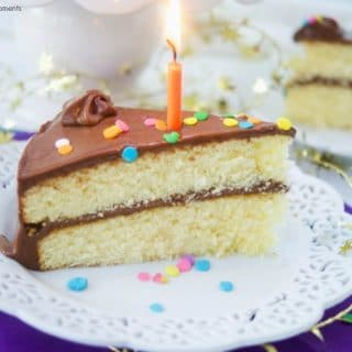 This creamy Chocolate Birthday Cake Icing Recipe is the best one you will ever try! Only requires 3 ingredients and is rich in real chocolate flavor. Slice with lit candle