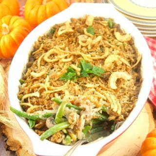 I've fancied up a classic Thanksgiving dish. This creamy Green Bean Casserole From Scratch recipe has lot's of onions, mushrooms, and green beans, & Gruyere cheese. Green beans facing out showing the creamy interior