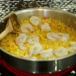 This delicious Curried Riced Cauliflower recipe with shrimp. Skillet in process with raw shrimp