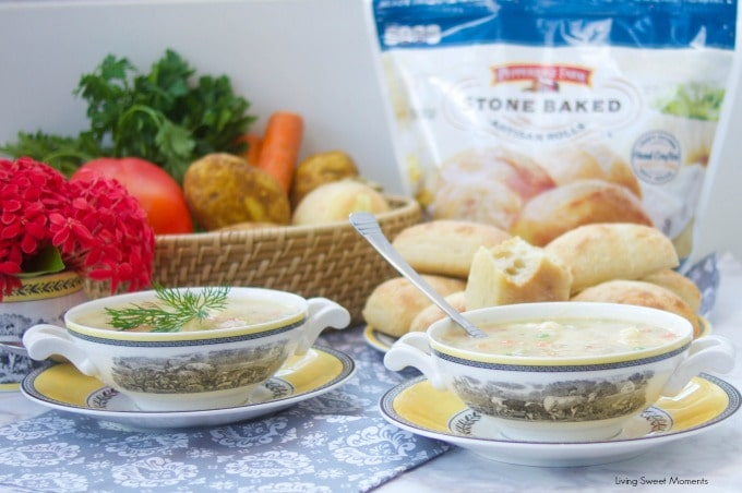 This creamy Potato Dumpling Soup recipe is the perfect hearty vegetarian soup. Shown here 2 soup bowls with pepperidge farm stone baked artisan rolls