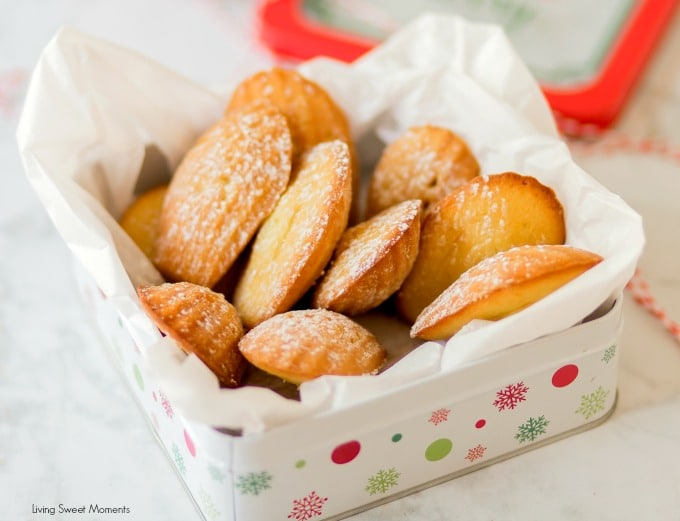 These Classic Lemon Madeleines cookies are placed on a cookie tin to give out as edible DIY Gifts