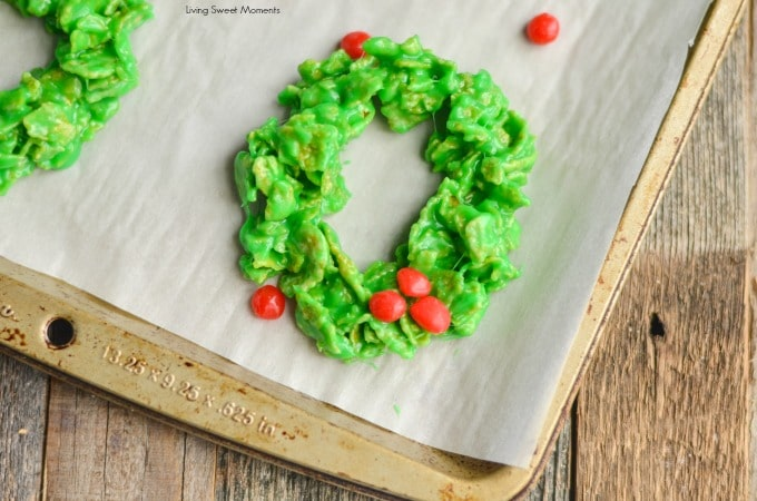 These easy and delicious Christmas Wreath Cookies require no baking & few ingredients. Perfect to make with kids. Give them out as gifts or for dessert.