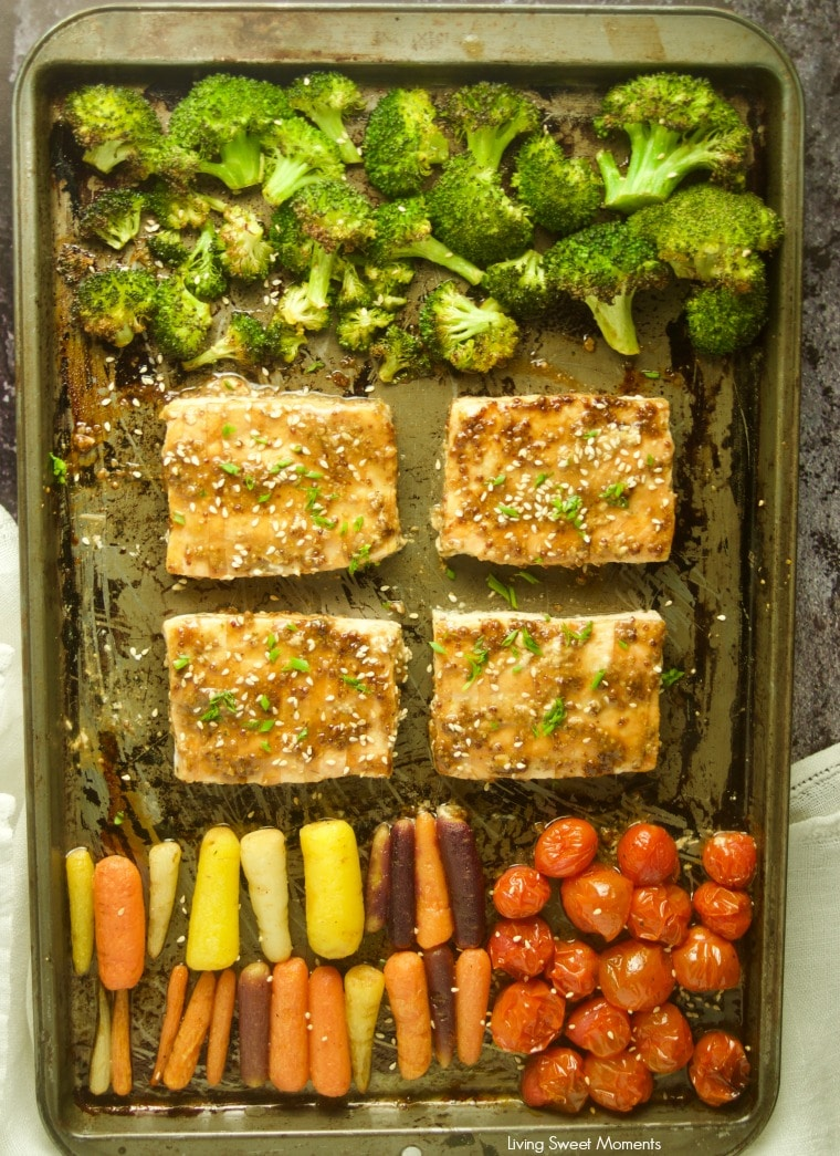 Enjoy this easy honey mustard sheet pan salmon with broccoli and colorful vegetables including carrots and tomatoes