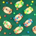 These fun M&M Football Cookies are the perfect kid friendly treat for the Superbowl, tailgating parties, sporting events and more. Use your favorite team colors to decorate
