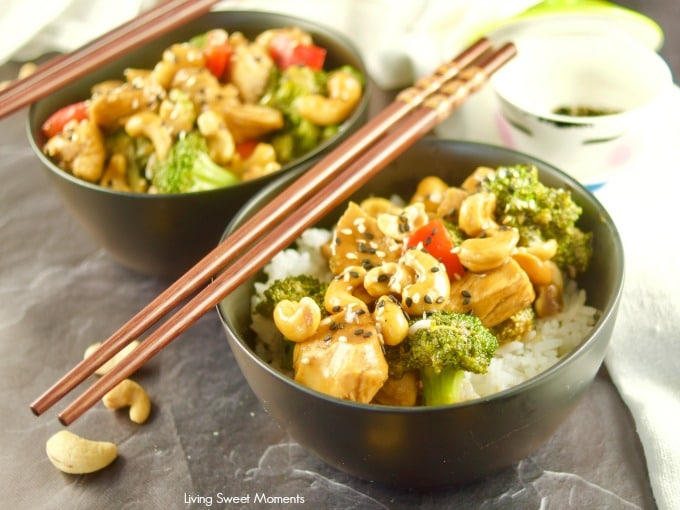This quick and easy pressure cooker Cashew Chicken recipe served in 2 black bowls with white rice