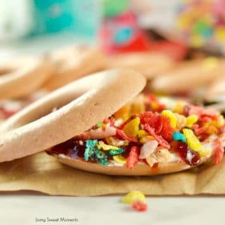 Yummy crunchy Fruity Pebbles Rice Cakes Sandwiches an easy to make snack that kids love. A closeup of the sandwich with cereal