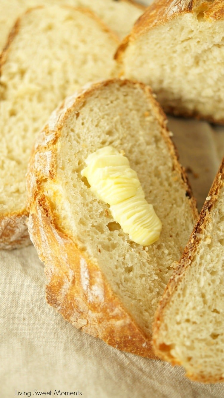 This crusty and delicious Instant Pot Sourdough Bread shows slices of bread with a little dab of butter