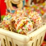 Celebrate Easter with these delicious no-bake Fruity Pebbles Eggs topped with a tangy lemon glaze. The perfect kid-friendly treat! Closeup shot