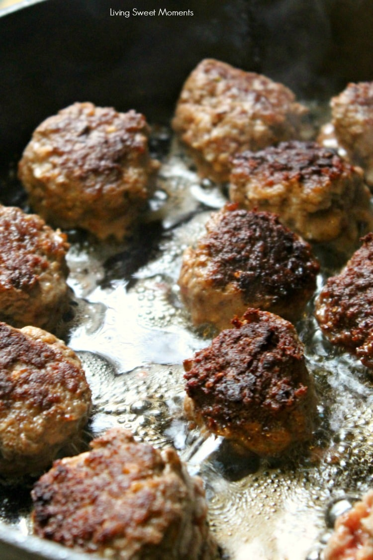 Delicious One Pot Greek Meatballs. Pictures shows meatballs browning in the pan with oil