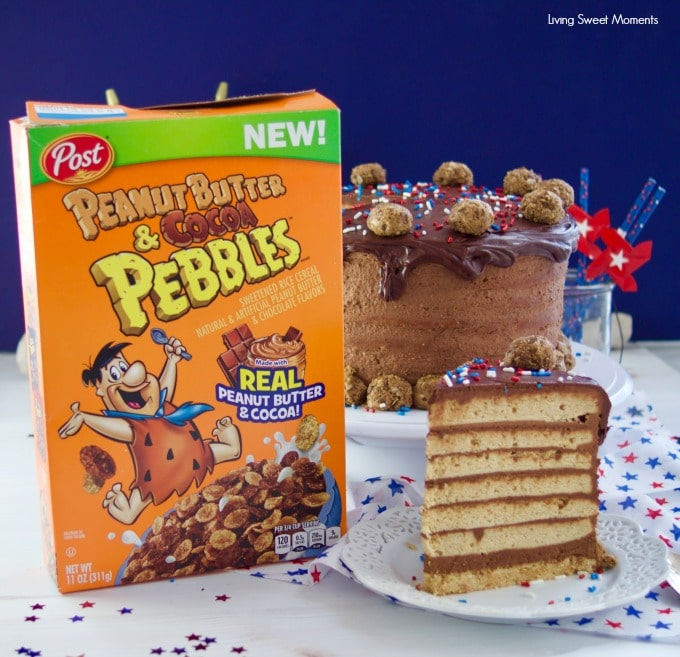 This colossal Peanut Butter Chocolate Cake recipe is made from scratch and is garnished with peanut butter truffles. Made with Peanut butter & cocoa Pebbles cereal