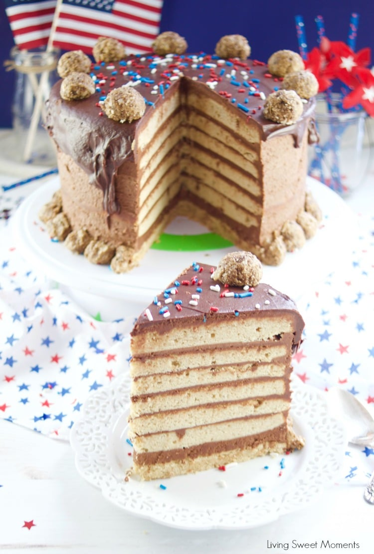 This colossal Peanut Butter Chocolate Cake recipe is made from scratch and is garnished with peanut butter truffles. Showing the cake and a slice