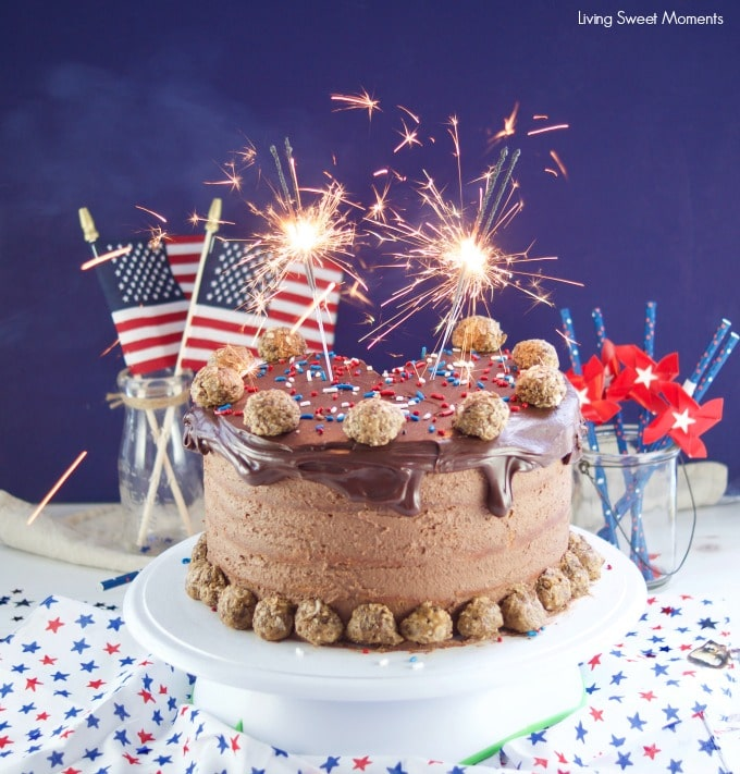 This colossal Peanut Butter Chocolate Cake recipe is made from scratch and is showing as the ultimate celebration cake for the 4th of july