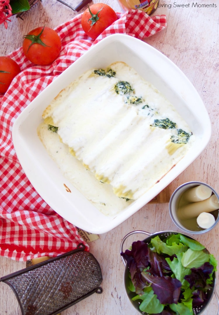 Enjoy a delicious vegetarian comfort dinner under an hour with this cheesy Spinach Artichoke Manicotti baked in a rich Bechamel sauce and hearts of palm