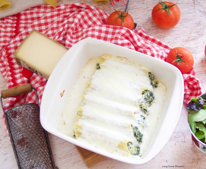 Enjoy a delicious vegetarian comfort dinner under an hour with this cheesy Spinach Artichoke Manicotti with bechamel sauce and mozarella cheese