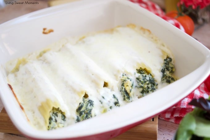Enjoy a delicious vegetarian comfort dinner under an hour with this cheesy Spinach Artichoke Manicotti baked in a rich Bechamel sauce showing in a red square pyrex