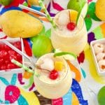 These refreshing Mango Lychee Wine Slushies have a touch of acid and garnished with a bamboo straw