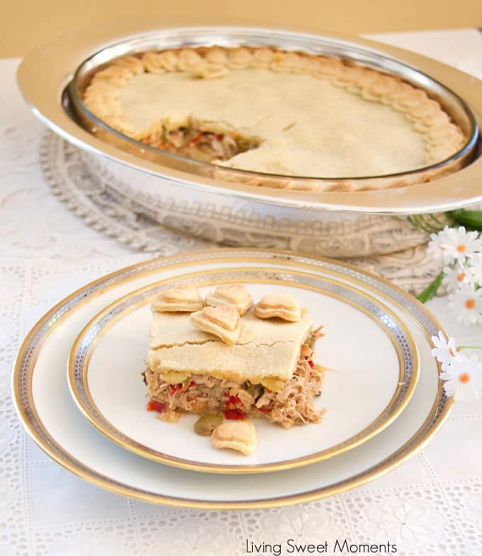 This savory shortcrust chicken pie (Polvorosa de Pollo) is made Venezuelan style by filling it with yummy shredded chicken, olives, raisins, and capers.