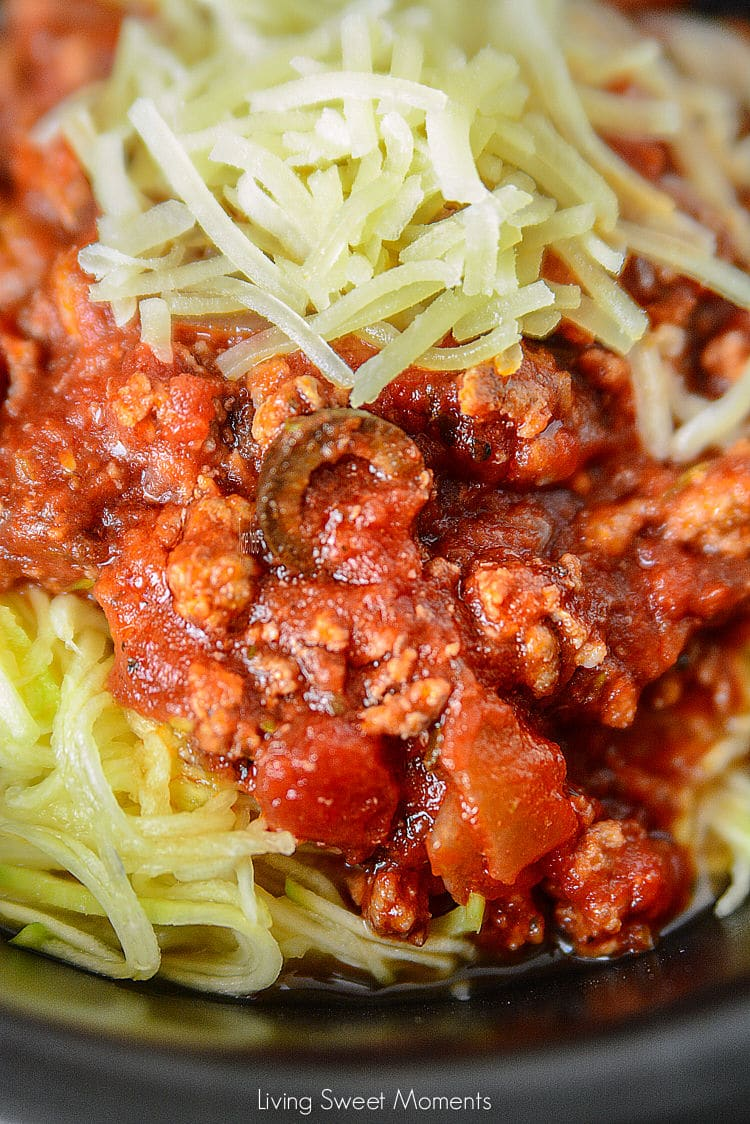 Come home to a delicious and comforting meal. This hearty Slow Cooker Sausage Puttanesca is served with zoodles. The perfect low-carb weeknight dinner idea.
