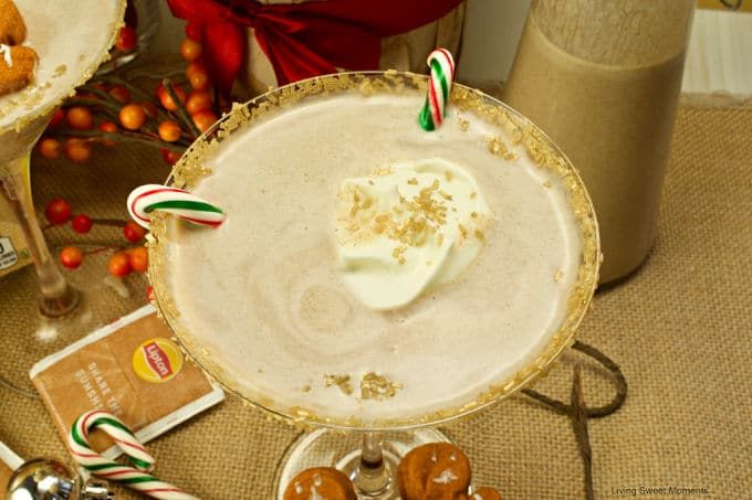 Get in the Holiday spirit with this creamy and flavorful Chai Tea Eggnog Cocktail served on a martini glass and garnished with fresh whipped cream.