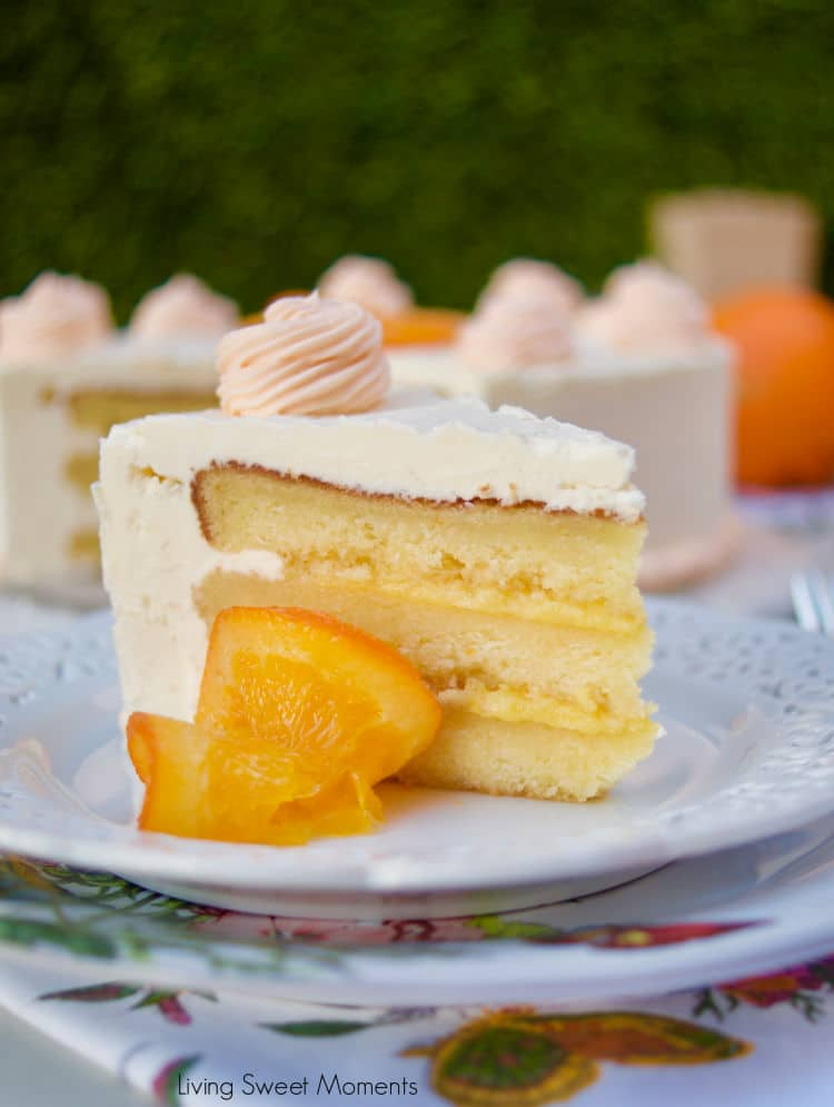 This amazing Succulent Orange Curd Cake consists of 3 layers of moist orange cake filled with orange curd and topped with Swiss vanilla buttercream.