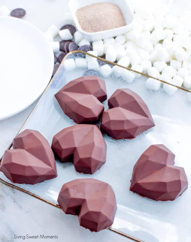 When you pour hot milk over these hot chocolate bombs, they melt and magically release the coffee, marshmallows, and cocoa hiding inside.