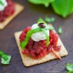 A delicious an easy appetizer! These Roasted Beet and Goat Cheese Crackers are garnished with fresh basil and balsamic vinegar reduction.
