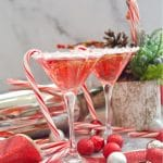 Treat yourself these Holidays with a fizzy Candy Cane Cosmopolitan mocktail that is delicious, easy to make, and great for the whole family