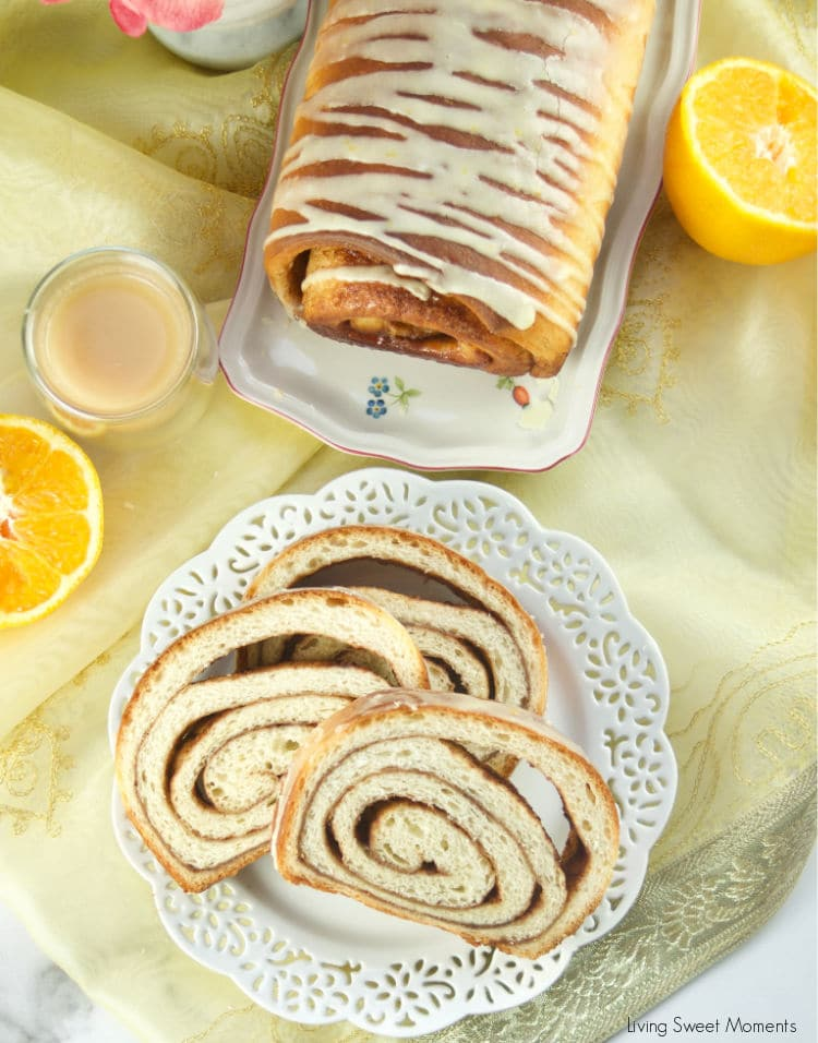 This Chai Spiced Bread is the perfect fluffy white loaf of bread, swirled with gooey chai spice and sugar in the middle topped with a sweet & tangy orange glaze
