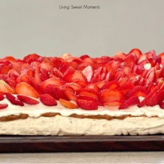 This delicious Pavlova With Dulce de Leche is made with walnut meringue, dulce de leche, whipped cream, and strawberries. Just like the famous Miami Dessert!
