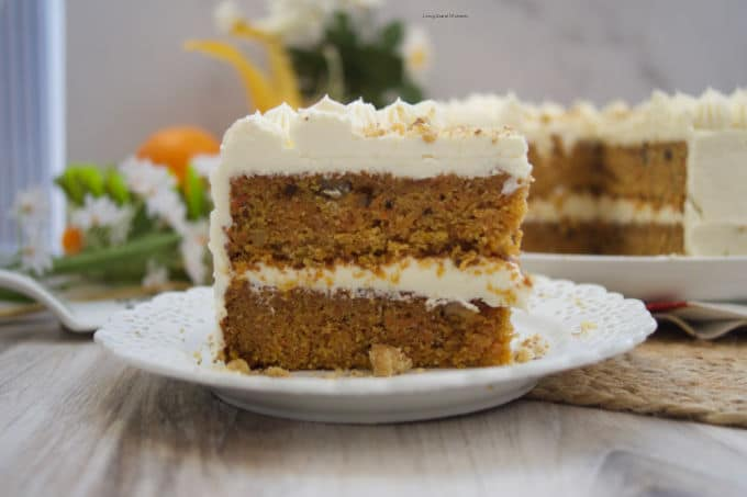 This stunning spiced Orange Ginger Carrot Cake is moist, tender, and delicious. Covered with cream cheese frosting. Have a slice!